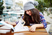Charming pretty girl sitting at cafe — Stock Photo