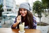 Young woman enjoying a drink — Stock Photo