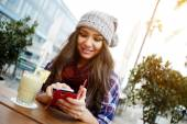 Woman sending text message from cafe — Stock Photo