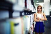 Caucasian smiling student with book — Stock Photo