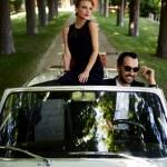 Happy couple enjoying a ride on car — Stock Photo #74411541