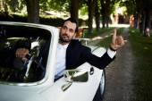 Wealthy businessman in luxury car — Stock Photo