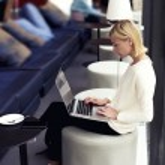 Female freelancer working on laptop computer — Stock Photo #77272696