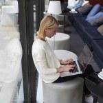 Female freelancer working on laptop computer — Stock Photo #77274386