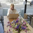 Freelancer working on the distance in cafe — Stock Photo #77274728