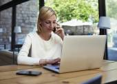 Businesswoman busy working in loft office — Stock Photo