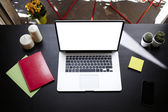 Freelance workplace with empty display notebook on modern table in home interior — Fotografia Stock