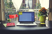 The laptop is on the table in front of an open window — Stock Photo