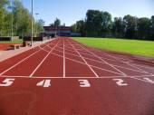 Red racetrack on the stadium — Stock Photo
