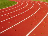 Red Running Track with white lines — Stock Photo