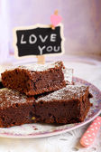Chocolate brownies dusted with icing sugar  — Stock Photo
