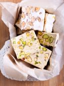 Honey and different sorts of nut nougat  — Stockfoto