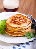 Pile of sweetcorn and herb pancakes — Stock Photo