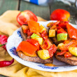 Grilled rye toast with vegetables. vegetarian appetizer — Stock Photo #53847217