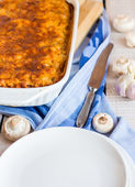 Fed meat lasagna dish on belots  — Stock Photo