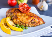 Whole chicken fillet baked in a spicy sauce with vegetables  — ストック写真