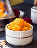 Pumpkin puree in a ceramic plate, vegetarian food   — ストック写真