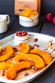 Slices of baked pumpkin with honey, cinnamon and nuts  — ストック写真