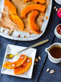 Baked pumpkin slices with cinnamon and nuts, spoon with honey  — ストック写真
