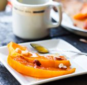 Baked pumpkin with cinnamon and nuts on a white plate  — ストック写真