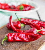 Raw chili pepper on a cutting board, raw food — Stock Photo