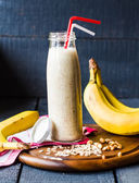Banana smoothie with oatmeal and nut paste — Stock Photo