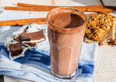 Chocolate smoothie with a banana with milk in a glass — Stock Photo