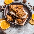 Granola bars citrus, peanut butter and dried fruit, healthy food — Stock Photo #65423723