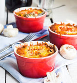 Baked mushroom julienne potatoes and tomato with cheese, lunch — Zdjęcie stockowe