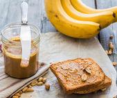 Crispy toast with peanut butter, bananas, breakfast — ストック写真
