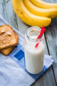 Banana smoothie, toast with peanut butter, roasted peanuts, brea — Stock Photo
