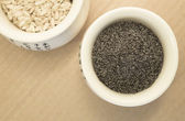Poppy seeds and rice in a cup — Stock Photo