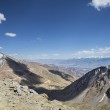 Aerial view to serpentine road, mountain range and valley of Leh from road to Khardung La pass — Stock Photo #59699381