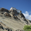 Ancient Buddhist temple on cliff over the road — Stock Photo #59699431