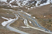 Group of bikers on winding road aerial view — Stock Photo