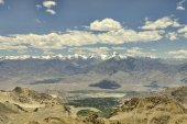 Aerial view to snow mountain range clouds and green valley — Stock Photo
