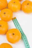 Mandarins and the meter line — Stock Photo