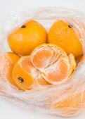 Mandarins in the polyethylene bag — Stock Photo
