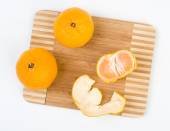 Mandarins on the kitchen cutting board — Stock Photo