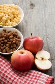 The simple food composition with apples and corn flacks — Stok fotoğraf