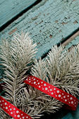 The New year tree on the wood backing — Stock Photo