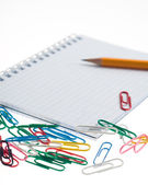 Pencil on the notepad with clips composition — Foto de Stock