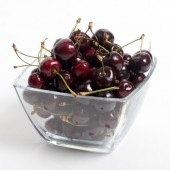 The cherries closeup  in the dish of glass — Stock Photo