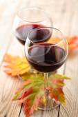 Red wine and autumn leaves. — Stock Photo