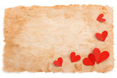 Ancient paper and hearts. — Stock Photo