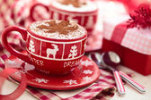 Cups with hot chocolate for Christmas day. — Stock Photo