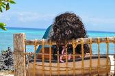 Woman sitting watching the sea — Stock Photo