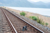 Hiking boots on the railway line — Stock Photo