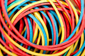 Rubber bands, colored background — Foto Stock
