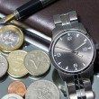 Wrist watch. coin. close — Foto de Stock   #73785231